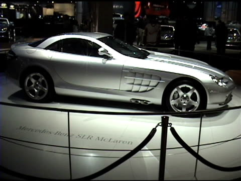 ws front end of slr mclaren revolving on turntable / ws passenger side and rear end on turntable / cu rear end passing through frame 2004... - mercedes benz stock videos & royalty-free footage