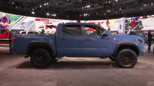 stockvideo's en b-roll-footage met shot front end of truck / closeup toyota type on grille zoom out ws front end / cu sign on windshield zo ws front end / ws high angle looking down on... - toyota motor