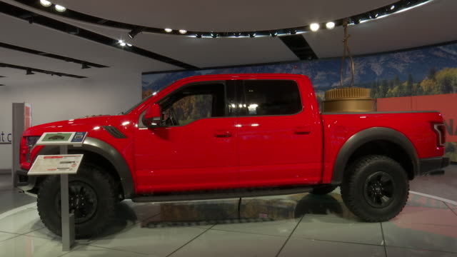 cu front end zoom out ws / cu motor trend truck of the year award zo ws of award in glass case next to truck / ws driver side profile / cu window... - ford truck stock videos and b-roll footage