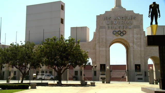 ws pan front entrance of los angeles memorial coliseum home of the 1932 and 1984 summer olympics and home of usc trojans football team / los angeles, california, usa  - the olympic games stock videos & royalty-free footage