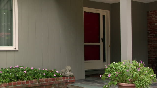 Front entrance to house / professional woman coming home from work / opening screen door