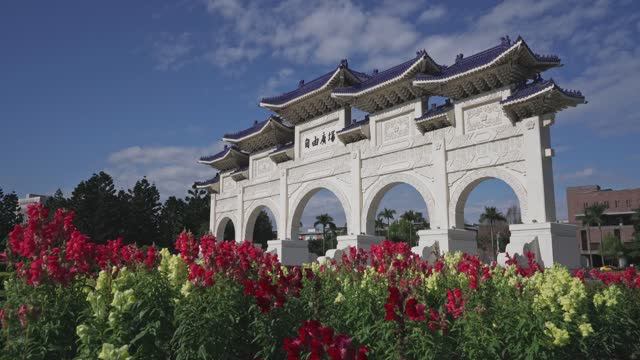 front gate of chiang kai-shek memorial hall with beautiful flowers in spring, taipei, taiwan. - chiang kaishek memorial hall stock videos & royalty-free footage