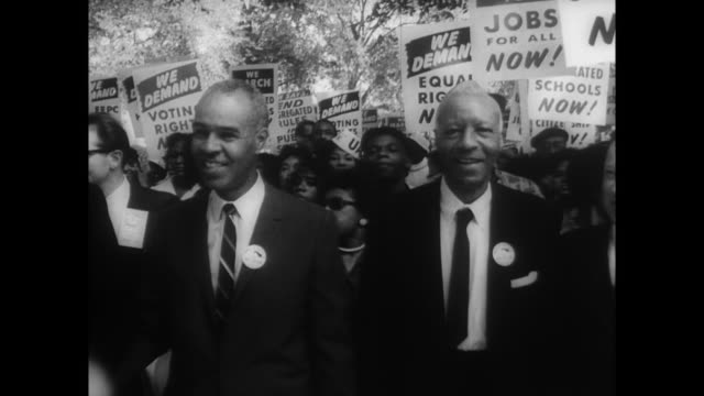 front line of march includes roy wilkins asa philip randolph martin luther king jr and walter reuther head of auto workers - marciare video stock e b–roll