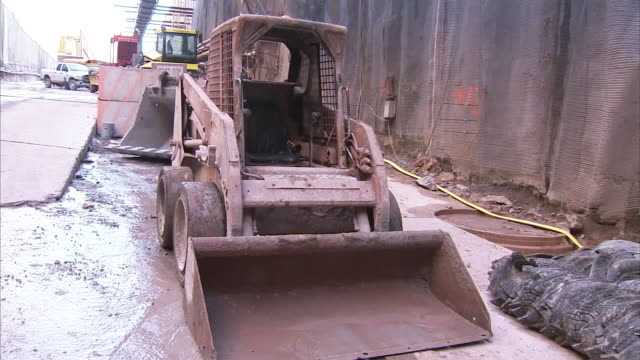 a front loader is parked by a wall at a niagara river tunnel boring operation. - river niagara stock videos & royalty-free footage