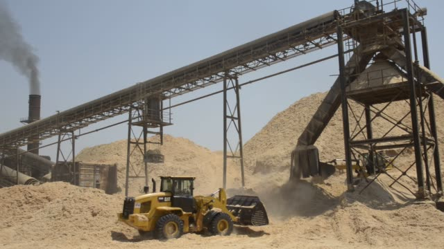 Front Loaders move sugar cane bagasse used for electricity