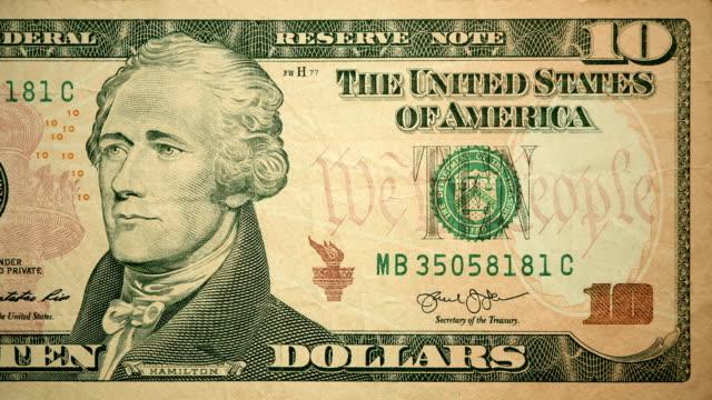 front of $10 dollar bill currency of the united states of america - banconota da 10 dollari statunitensi video stock e b–roll