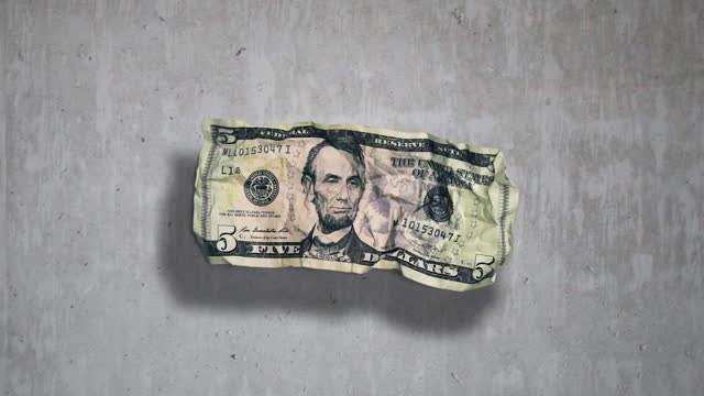 front of $5 dollar bill on grey concrete background - making money stock videos & royalty-free footage