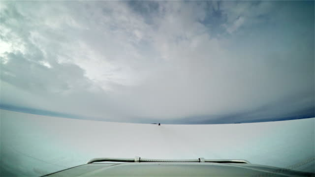 Front of a car while driving over the salt