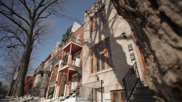 front of a few housing and trees in front - montréal stock videos & royalty-free footage