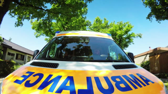 ld front of an ambulance vehicle driving in suburb on a sunny day - day stock videos & royalty-free footage