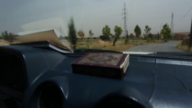pov front of car driving near lebanon / syrian border - syrien stock-videos und b-roll-filmmaterial