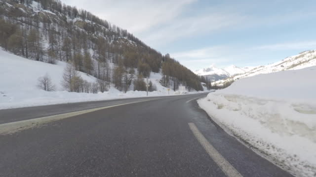 front of car pov on mountain road - mountain road stock videos & royalty-free footage