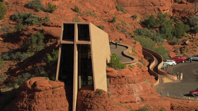 ms aerial zo front of chapel of the holy cross and walkway to chapel / sedona, arizona, united states  - chapel stock videos & royalty-free footage