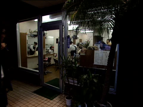 front of hairdressers' salon and man entering - 1991 stock videos and b-roll footage