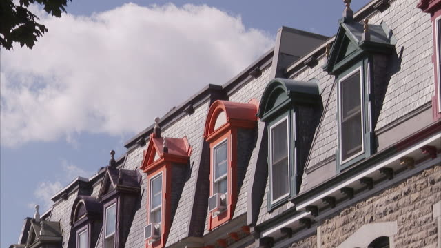 front of houses w/ colorful windowsills amp frames along - fensterbank stock-videos und b-roll-filmmaterial