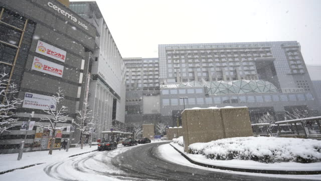 front of kyoto station in snow falling winter - kyoto stock videos and b-roll footage