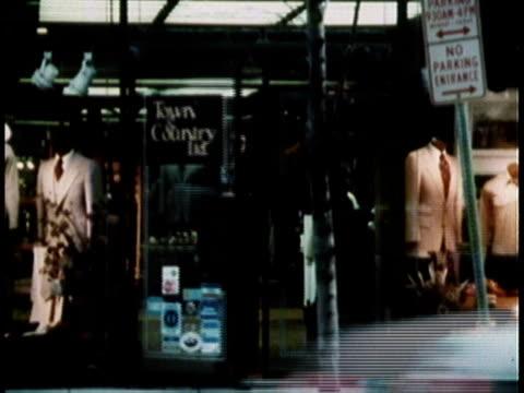 vídeos y material grabado en eventos de stock de 1979 ws front of men's clothing store / united states - ropa de caballero
