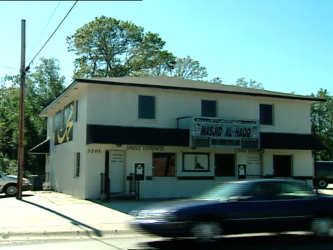 * good ws front of mosque w/ 2 entrances white building w/ black trim unidentifiable african american male standing in doorway 2nd unidentifiable... - sedan stock videos & royalty-free footage