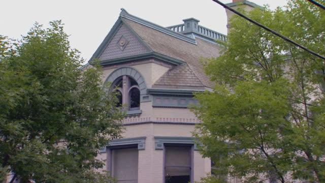 front of older home  - れんが造りの家点の映像素材/bロール