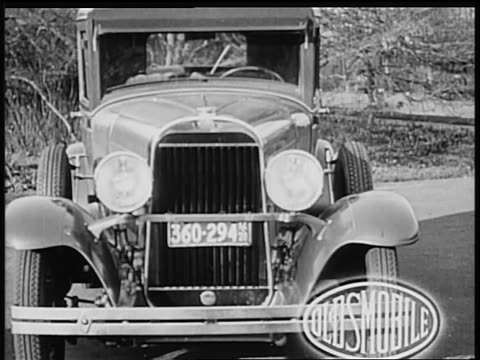 b/w 1928 front of oldsmobile car / industrial - 1928 stock videos & royalty-free footage