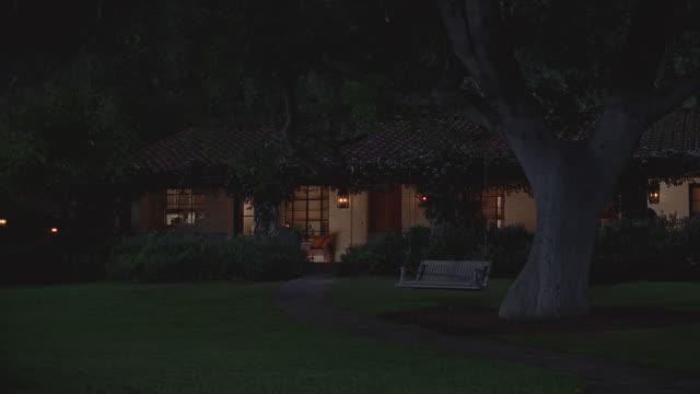 ds front of single-story suburban home with lights-on at night / santa barbara, california - サンタバーバラ点の映像素材/bロール