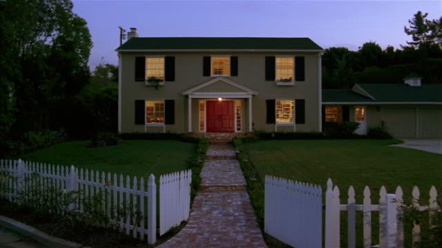 Front of suburban house with lights on at twilight / Santa Barbara, California