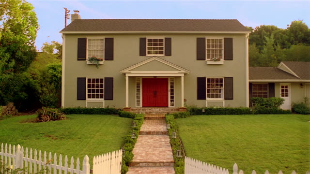front of suburban house with white picket fence / santa barbara, california - picket fence stock videos and b-roll footage