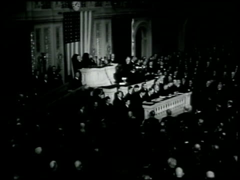 stockvideo's en b-roll-footage met front of white house ha ws franklin d roosevelt addressing congress pan congress listening ws soldier sentry guarding standing on steps w/ capitol... - 1942