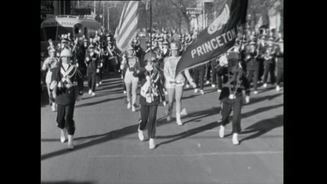 front on shot marching band parades through street - 1961 stock videos & royalty-free footage