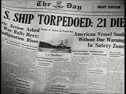front page of 1917 newspaper headlines 'ship torpedoed 21 die' dramatization td ws us american flag floating in water - 1917 stock-videos und b-roll-filmmaterial