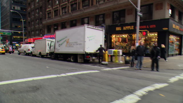 pov / front / side view / front passenger side view from car driving down on park avenue in midtown / new york city, new york, united states - ladenschild stock-videos und b-roll-filmmaterial