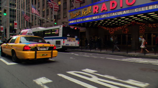 pov / front / side view / front passenger side view from car driving down park avenue in midtown / new york city, new york, united states - radio city music hall stock videos & royalty-free footage