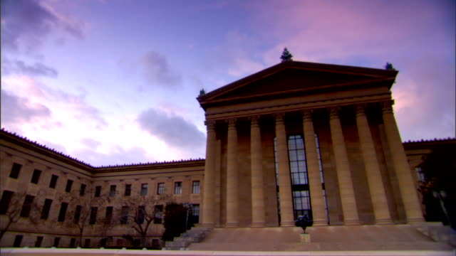 front portico of philadelphia museum of art w/ pillars blue sky w/ pink clouds bg parthenon on the parkway greek revival architecture fairmount park... - center city philadelphia stock videos and b-roll footage