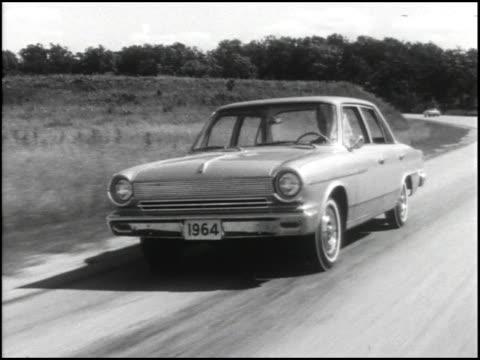 front quarter driver side view of 1964 amc rambler american 440 four-door sedan / front end / rear three-quarter driver side view; slow to rear... - dreiviertelansicht stock-videos und b-roll-filmmaterial