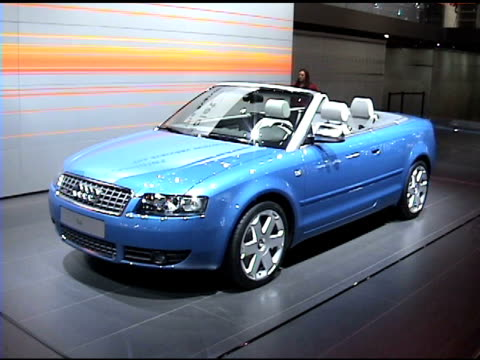 stockvideo's en b-roll-footage met front quarter driver side view of audi s4 cabriolet; tilt up to wall sign 2004 audi s4 cabriolet at cobo hall on january 14, 2004 in detroit, michigan - quarter