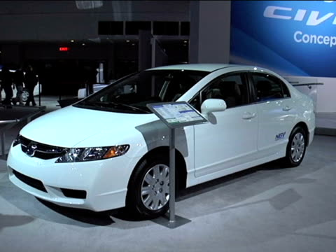 front quarter driver side view of honda civic gx / ngv logo on civic's door / rear three-quarter driver side view 2011 honda gx natural gas vehicle... - three quarter length stock videos & royalty-free footage