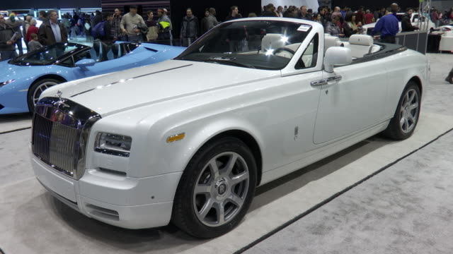 ws front quarter driver side view / zo ws rear quarter driver side view / ws la front quarter passenger side view / pan left ms white leather seats /... - rolls royce stock videos & royalty-free footage