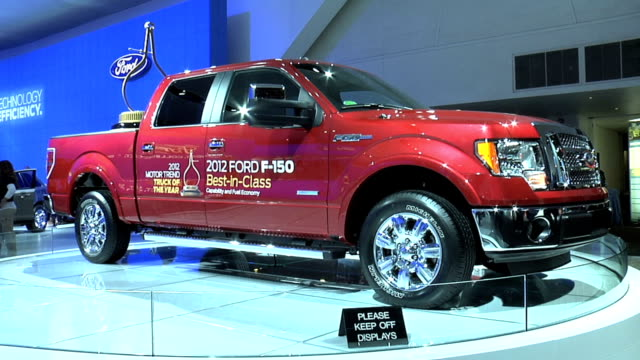 front quarter passenger side view of ford f-150 with model of motor trend magazine's calipers award trophy in the payload area 2012 ford f-150 motor... - calliper stock videos & royalty-free footage