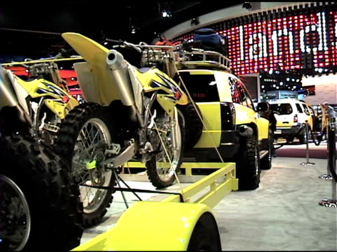 ws front quarter passenger side view of suzuki dune concept truck / ws rear three quarter passenger side view behind trailered dirt bikes / cu suzuki... - curious cumulus productions stock videos and b-roll footage