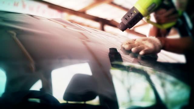 front side car window tinting series : heat shrinking window film. - avvolto video stock e b–roll