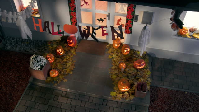 hd crane: front stoop with halloween decorations - halloween stock videos & royalty-free footage