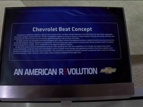 front three-quarter driver side view of chevrolet beat / info sign / rear end---narrator voiceover erroneously mentions the beat will go into... - dreiviertelansicht stock-videos und b-roll-filmmaterial