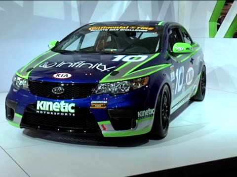 front three-quarter driver side view of kia forte koup race car / info sign---footage is 4:3 anamorphic. it will play back at 853x480.--- 2010 kia... - dreiviertelansicht stock-videos und b-roll-filmmaterial