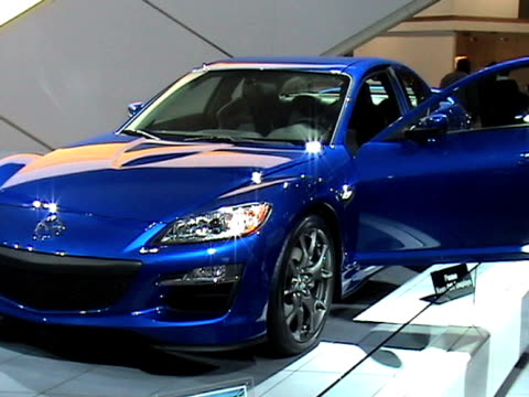 front three-quarter driver side view of mazda rx-8 / rear three-quarter driver side view / passenger side profile---footage is 4:3 anamorphic. it... - dreiviertelansicht stock-videos und b-roll-filmmaterial