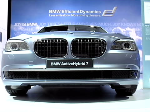 front three-quarter passenger side view of bmw / front end; to vanity plate / same as shot 1, but car is bathed in blue light / tilt down to bottom... - three quarter length stock videos & royalty-free footage