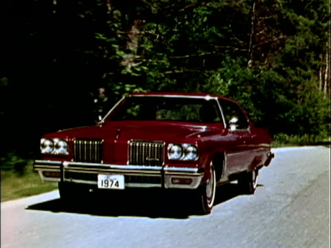 front three-quarter passenger side view of olds 98 sedan parked on road / rear three-quarter passenger side view of car driving on rural road / front... - three quarter length stock videos & royalty-free footage