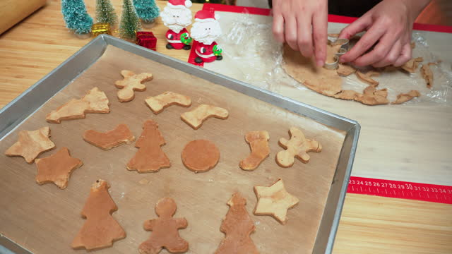 stockvideo's en b-roll-footage met front view: asian woman's hand press metal mold to make homemade christmas tree cookies, gingerbread, candy cane, a star from dough to celebrate christmas holiday's december. - star shape