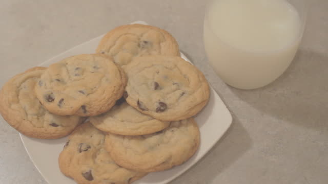 front view close up cookies on plate with milk - chocolate chip cookie stock videos and b-roll footage