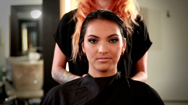 front view closeup of beautiful young woman in a hair salon - beauty salon stock videos & royalty-free footage