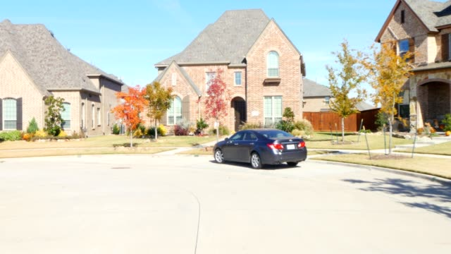 front view driving through residential houses in suburban estate street - townhouse stock videos & royalty-free footage